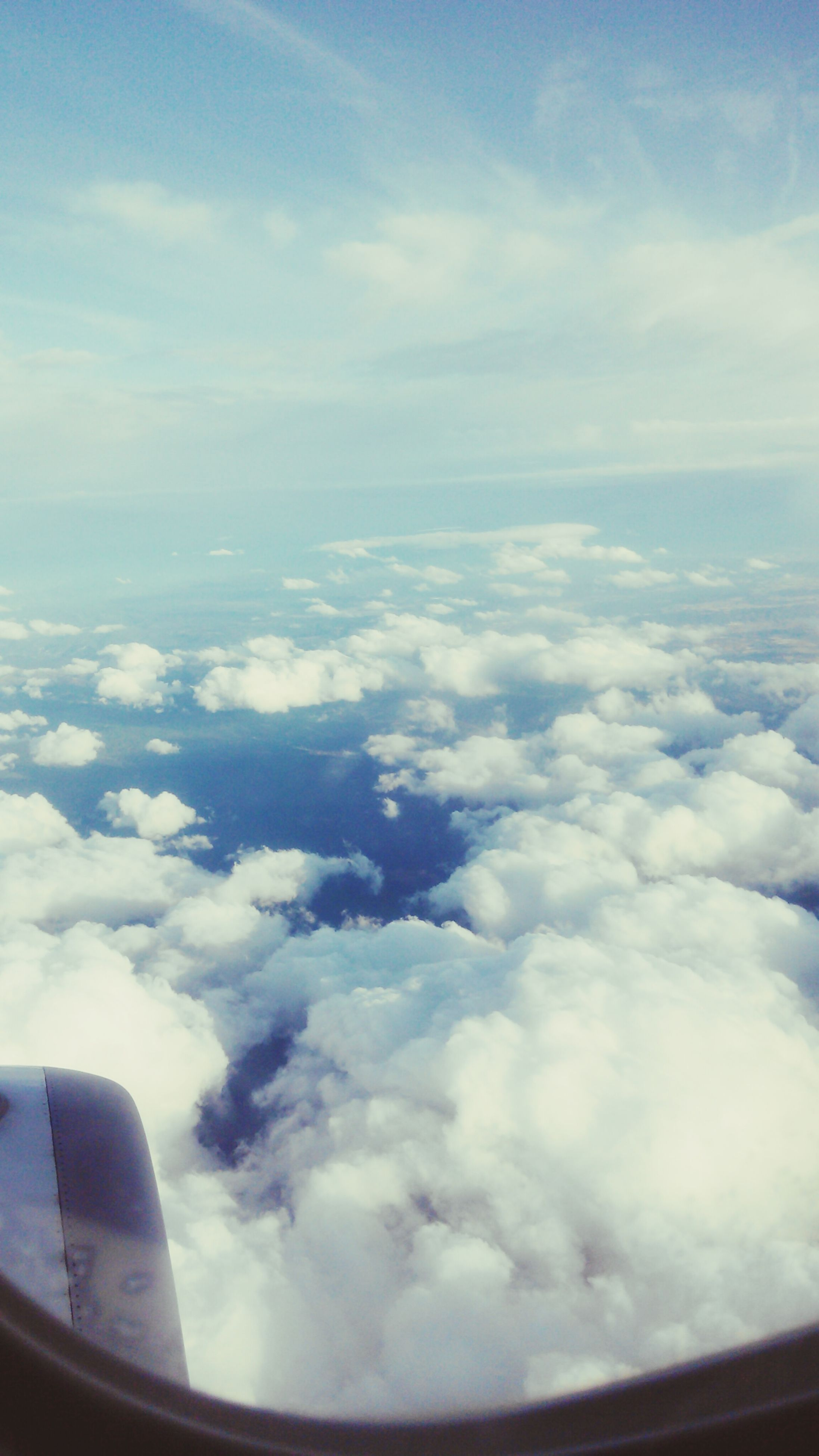 transportation, airplane, mode of transport, air vehicle, flying, part of, aircraft wing, aerial view, sky, cropped, vehicle interior, travel, cloud - sky, window, journey, mid-air, scenics, on the move, beauty in nature, glass - material