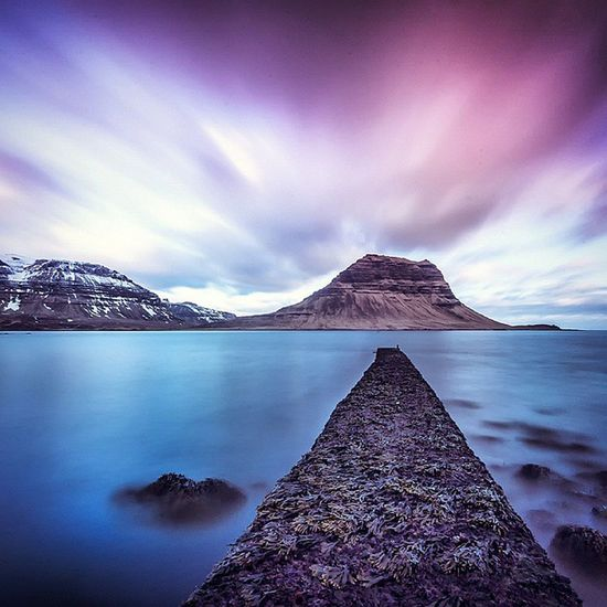 Kirkjufell after sunset. This was our first stop in Iceland. I photographed the mountain from the normal location we all see in the guide books and then I went back to our hostel in Grundarfjordur. I went for a walk around the beach and stumbled on this angle and thought it was something different. ------------ Exif Canon 1d mk3 Sigma 10-20mm F8, 200iso, 1.5 min, 10stop filter ------------ Odonnellphotography ig_iceland amazing_longexpo discoverearth sengajaphoto iceland grundarfjordur kirkjufell icelandic icelandtravel everydayiceland sea clouds landscape mountain seascape canon_photos skylovers skyshots pier blue 10stop ig_iceland119 hu_le_nature
