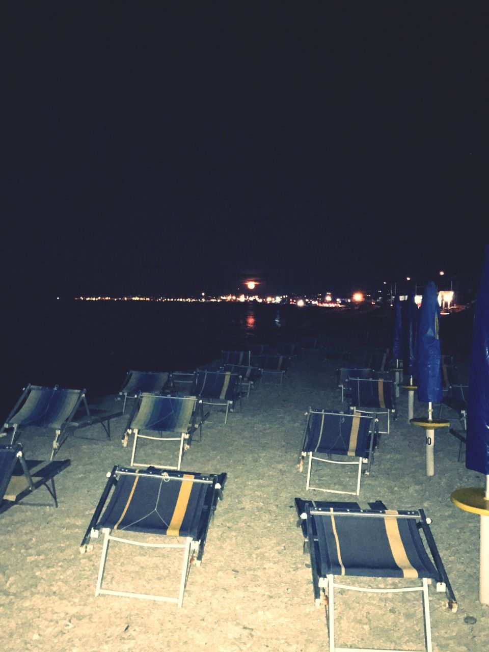 clear sky, night, chair, absence, no people, folding chair, outdoors, seat, sky