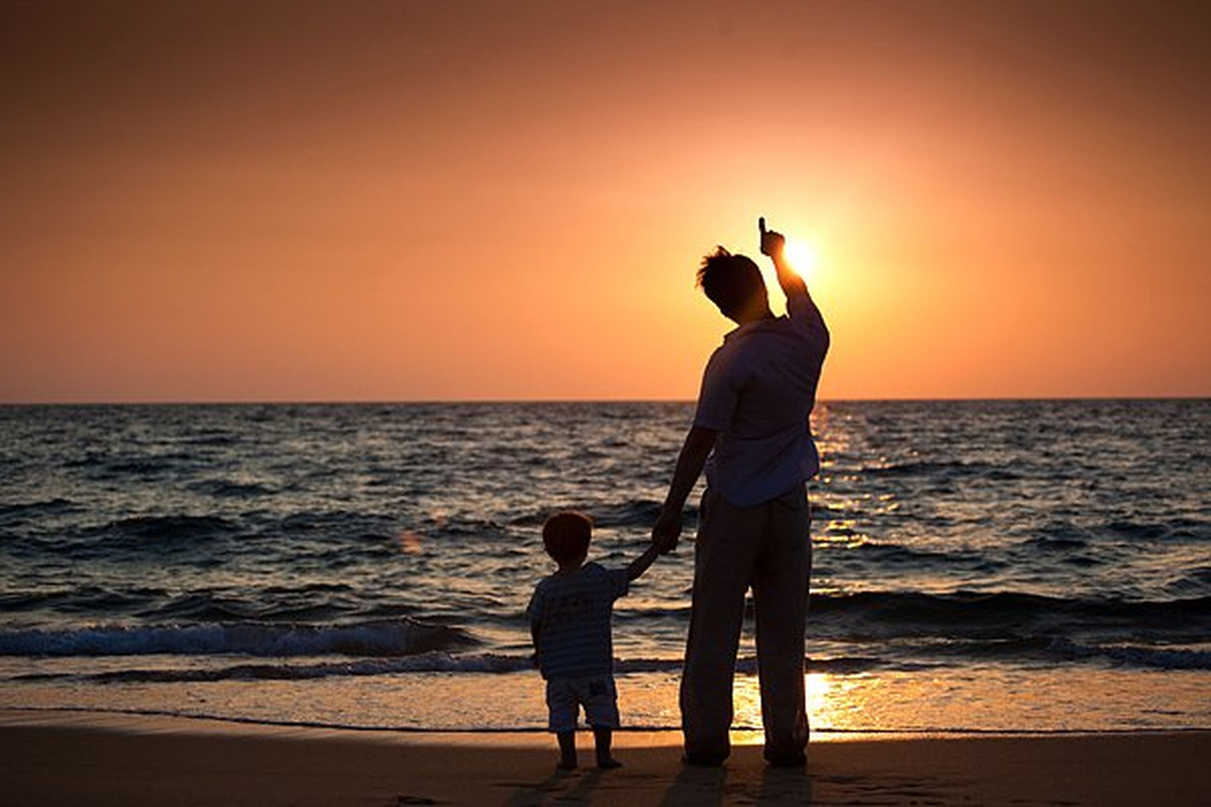 sea, child, beach, sunset, males, boys, happiness, horizon over water, family, human body part, outdoors, nature, two people, silhouette, adult, sand, people, vacations, beauty in nature, togetherness, day