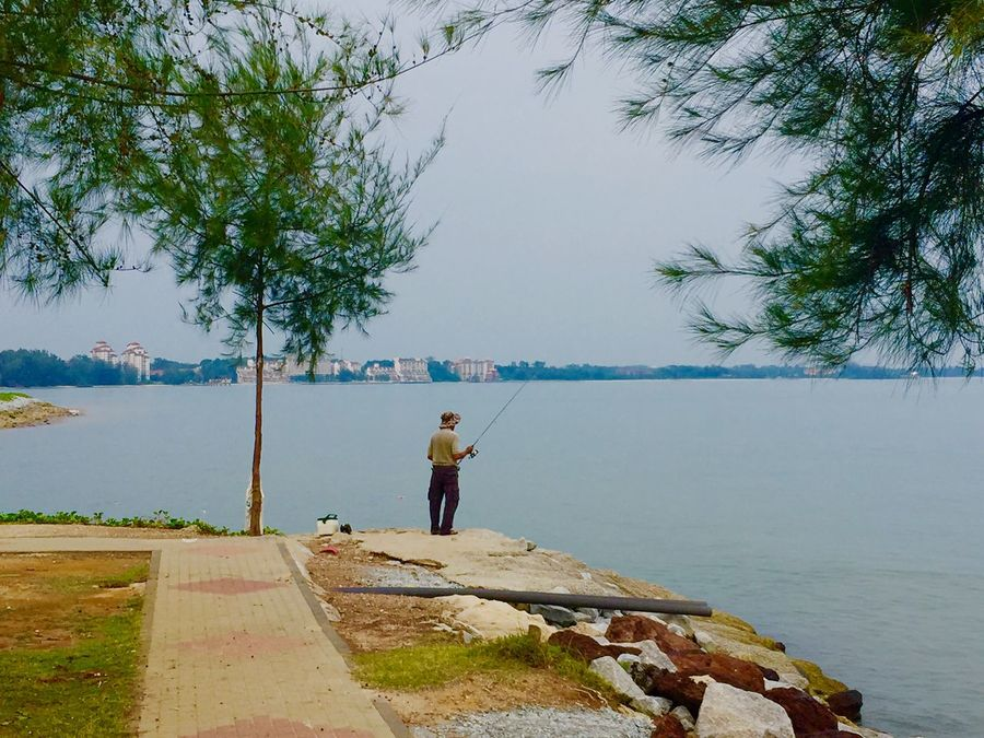 A fisherman in the bay of Port Dickson in Malaysia Fisherman Rod Fishermen Port Bay Malaysia Port Dickson Port Dickson, Malaysia