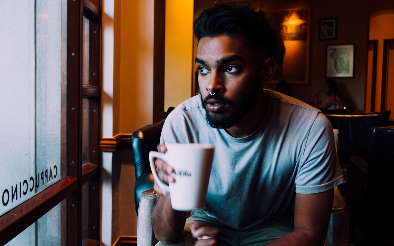 Cafe Cafe Latte Cafe Time Casual Clothing Coffee Cup Day Daydreaming Dream Dreaming Drink Focus On Foreground Food And Drink Holding Indoors  Latte Looking Out Of The Window Man Mug Person Refreshment Staring Thinking Thinking About Life Young Adult