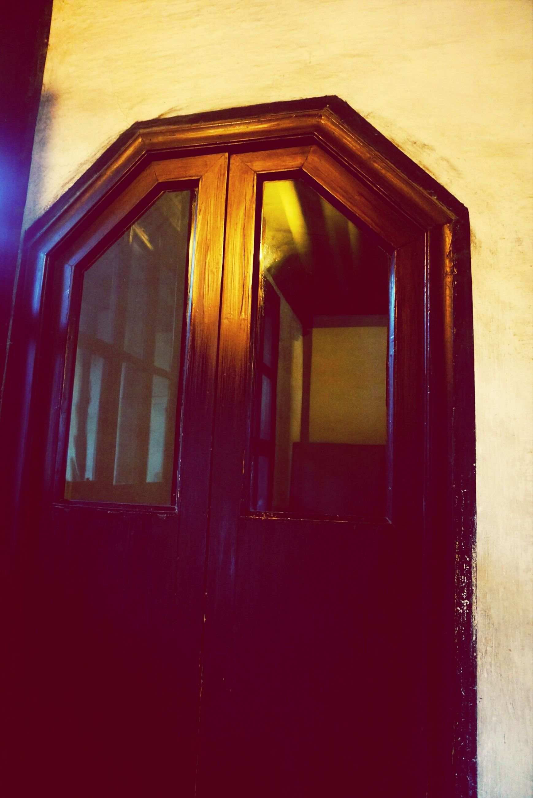 architecture, built structure, window, building exterior, house, low angle view, residential structure, residential building, no people, closed, door, yellow, building, wall - building feature, wall, sunlight, wood - material, indoors, shutter, day