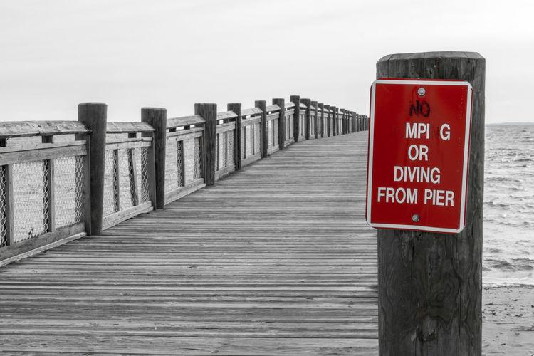 Beach Communication Day Guidance Horizon Over Water Nature Nikond3300 Outdoors Overcast Pier Sea Sky Text Walnut Beach Warning Sign Wood