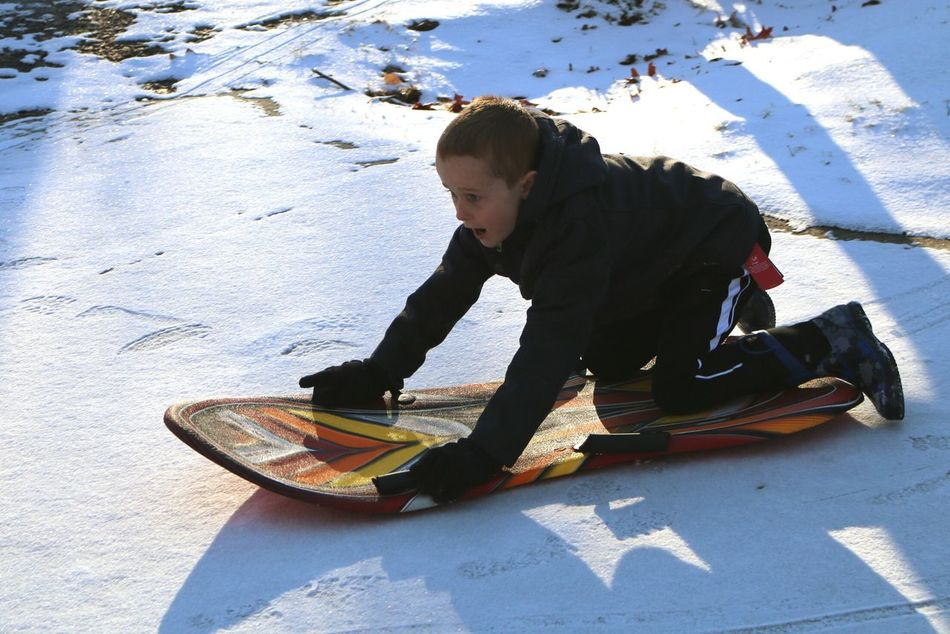 One Person Side View Leisure Activity Sunlight Full Length Outdoors Sport Sledding Snow Cold Temperature Child One Boy