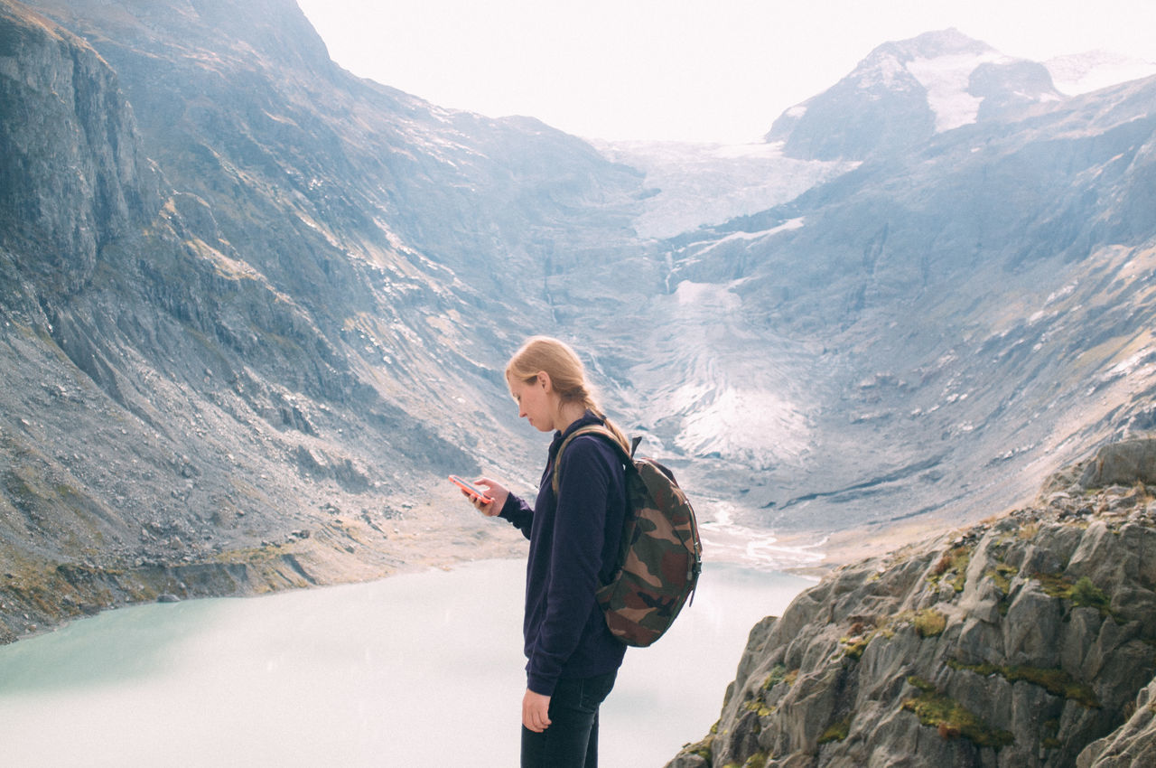 Beautiful stock photos of phone, Backpack, Day, Hiking, Holding
