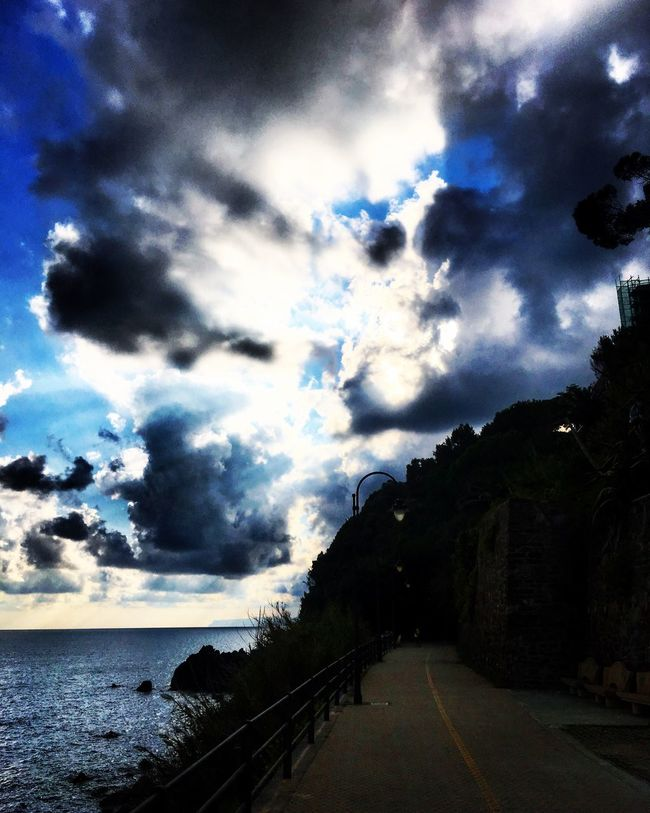 Road The Way Forward Transportation Empty Sea Sky Water Tranquil Scene Long Cloud Cloud - Sky Diminishing Perspective Scenics Tranquility Day Cloudy Blue Beauty In Nature Outdoors Nature