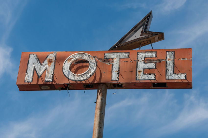Retro Motel Sign Americana Arrow Symbol Blue Close-up Day High Section Information Information Sign Low Angle View Motel Motel Sign Neon Neon Sign No People Pole Red Sign Retro Retro Sign Road Trip Sky Text Type USA Western Script