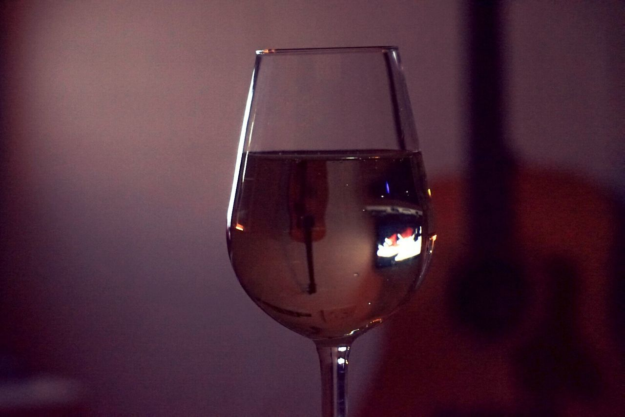Reflection Of Guitar On Wineglass