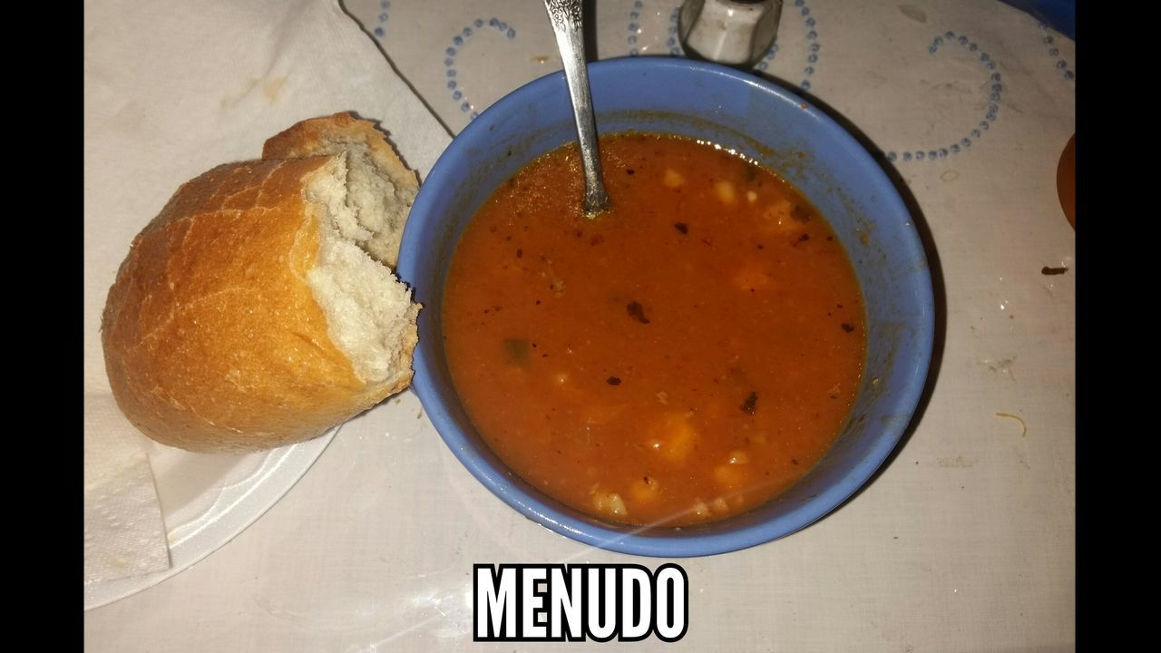 High Angle View Of Bread With Soup Served On Table