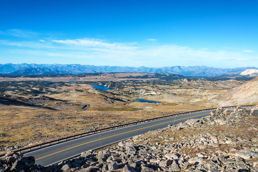 Highway passing through a dramatic alpine landscape in the Beartooth Mountains in Montana Alpine Bear Montana National Park Scenic Shoshone Travel Tundra USA Wanderlust Wyoming Beartooth Destination Forest Highway Landscape Mountain Mountains Overlook Peaks Plateau Range Tooth Valley Wilderness