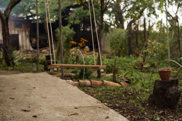 Cradle  Day Focus On Foreground Missing Children No People Outdoors Swinging Tree Village Yard