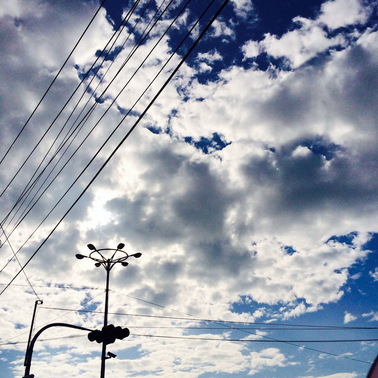 cloud - sky, sky, low angle view, cable, power line, electricity, day, no people, electricity pylon, outdoors, silhouette, power supply, nature