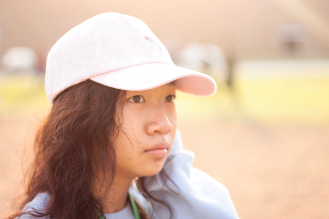 Real People Focus On Foreground One Person Headshot Lifestyles Young Women Close-up Hat Leisure Activity SLR Camera Bokeh Relaxing Hello World Teen Beautiful Woman Outdoors Portrait Young Adult Women Day Headwear