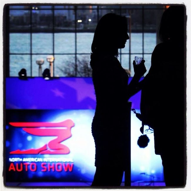 People enjoy drinking & talking before the ribbon cutting ceremony to open the charity preview at the Detroit Auto Show