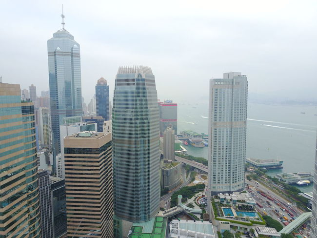 Architecture Building Exterior Built Structure City City Life Cityscape Day Development Downtown District Financial District  Growth High Angle View Modern Nature No People Outdoors Sky Skyline Skyscraper Tall Tall - High Tower Travel Destinations Urban Skyline Water