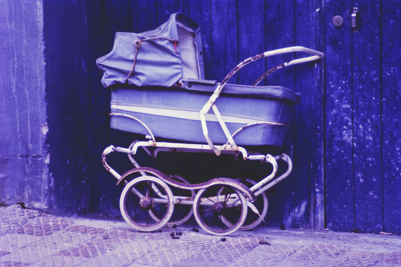 Europe, Portugal, Lisbon, old blue discarded pram standing at blue painted gate / wall Abandoned Architecture Baby Carriage Blue Color Color Image Day Discarded Gate Horizontal Lisbon No People Outdoors Portugal Pram Single Object