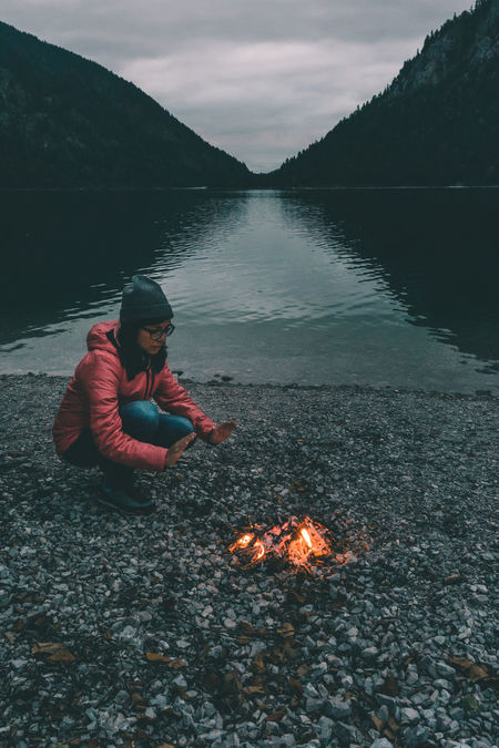 Adventure vibes at the warm bonfire Adventure Australia Autumn Bonding Bonfire Camp Camping Campvibes Cold Night Dark Darkness Darkness And Light Dusk Girl Lake Life Light Mood Plansee Vibes Warm Warming Hands Woman Österreich Camp