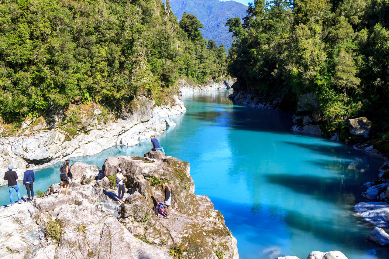 Hokitika Gorge, with bright blue water Beauty In Nature Blue Blue Water Day Eye4photography  EyeEm Nature Lover High Angle View Leisure Activity Men Nature One Person Outdoors People Real People Rock - Object Scenics Sea Sky Tree Water