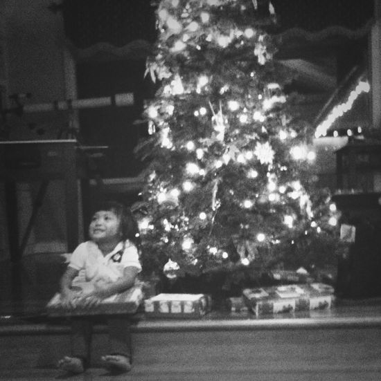 My cousin by the tree...can't wait till Christmas