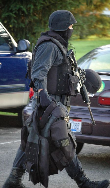 Swat Cops Police Swat Team Special Forces Hostile Hostage Gear Safety Equipment Car Transportation Land Vehicle Rear View Day Men Outdoors Real People Police Force One Person Adult People