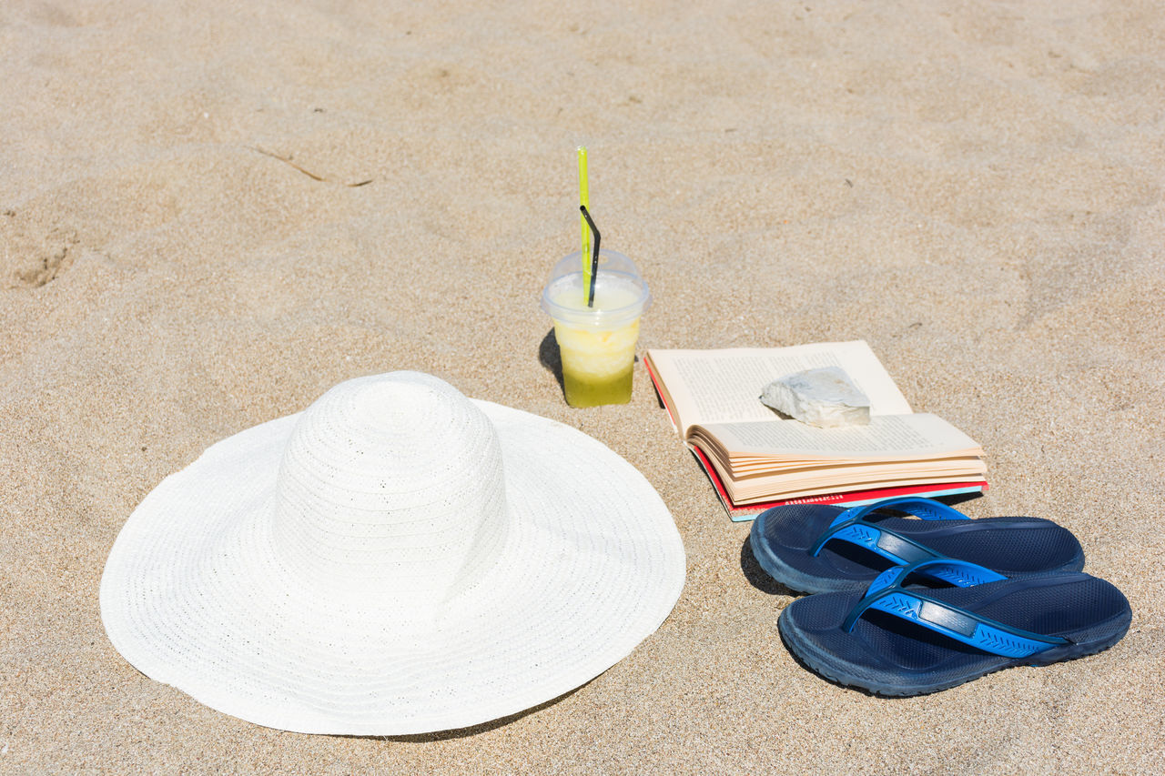 Beach Book Day Day Out Dayoff Drink Drinking Drinking Straw Hat High Angle View Holiday No People Outdoors Sand Sandals Sun Tanning Travel Travel Destinations Traveling Vacations