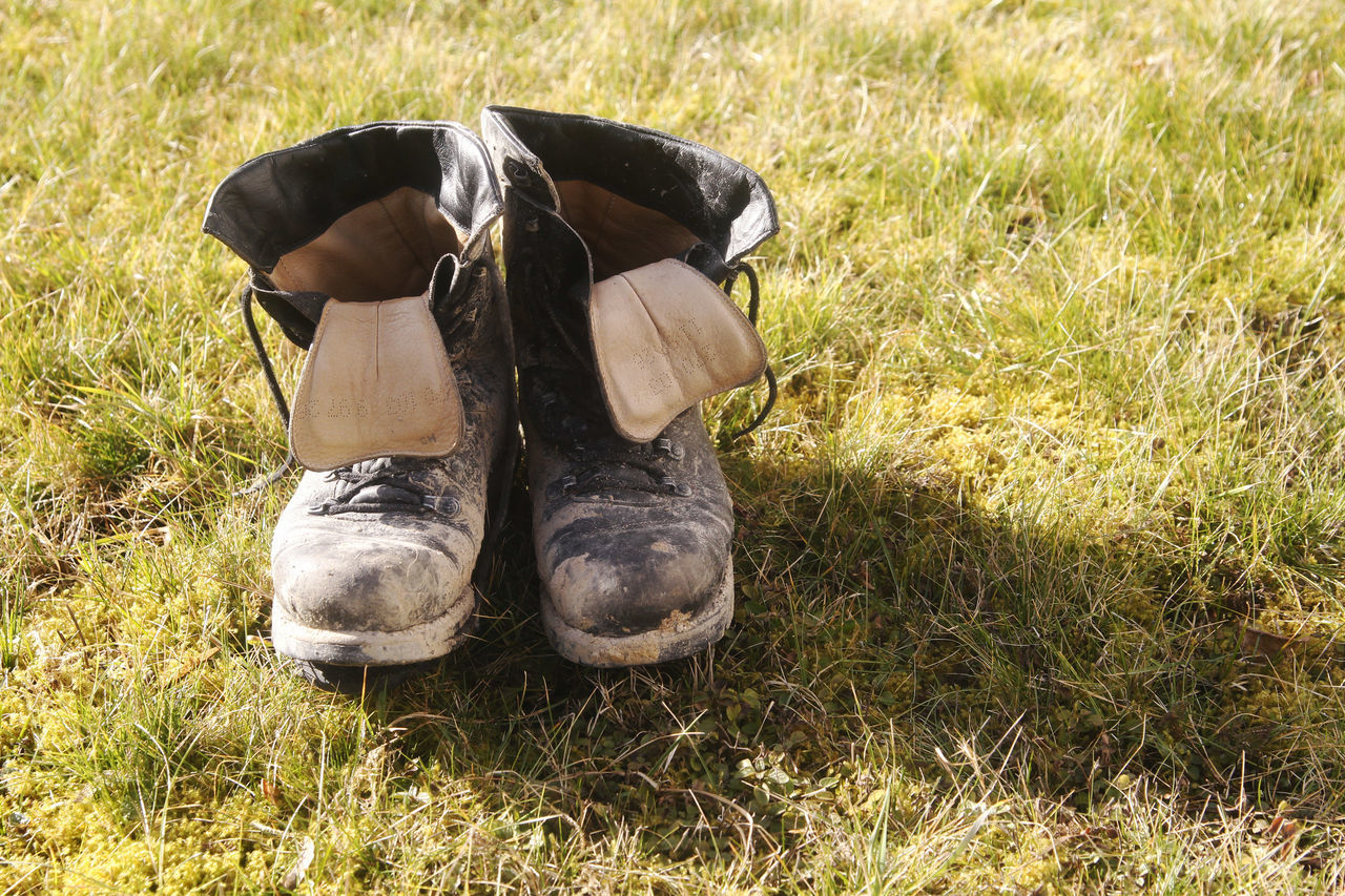Old shoes Adult Adults Only Day Field Grass Human Body Part Men Nature Old Shoes One Man Only One Person Outdoors People Shoes