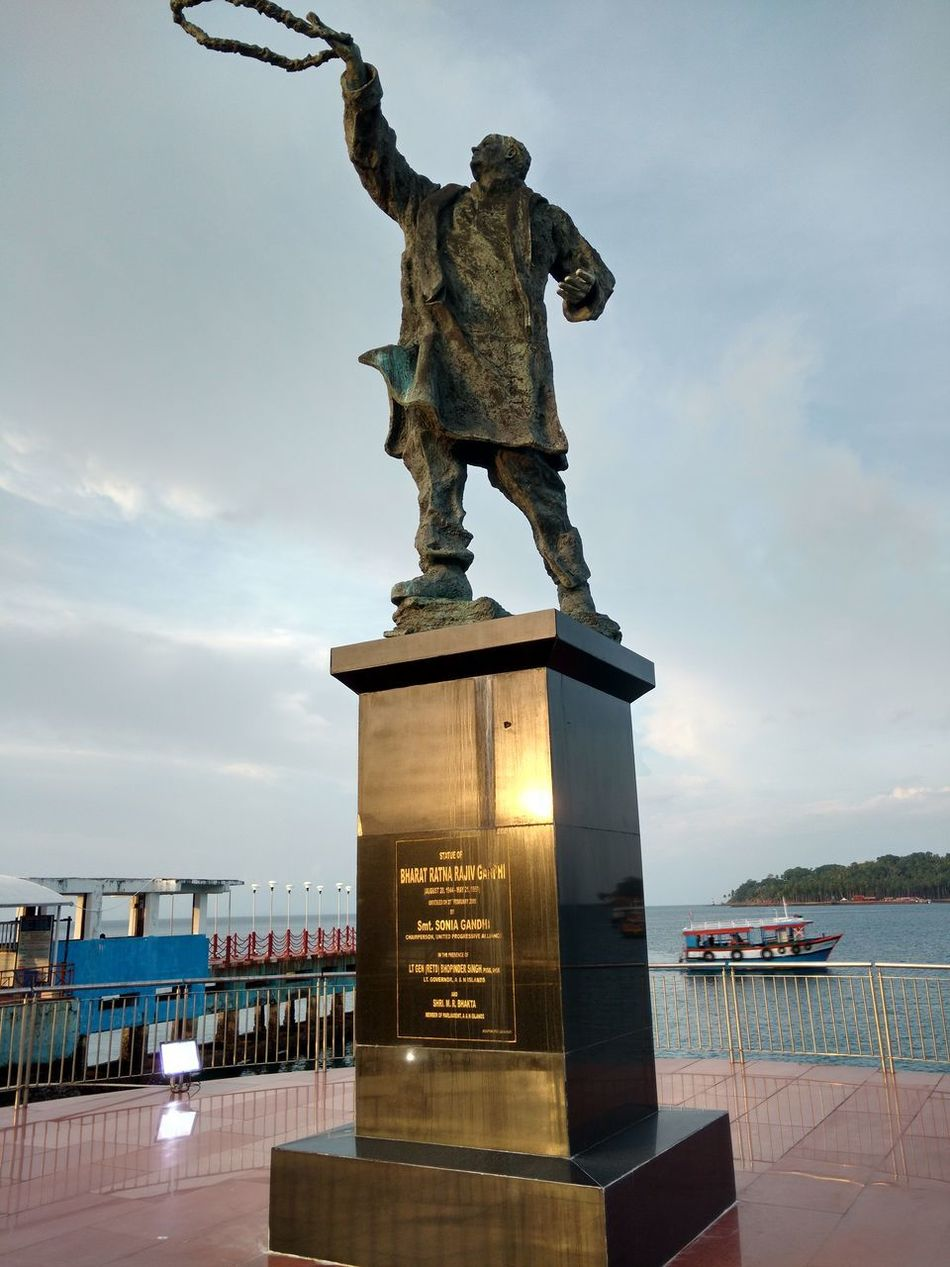 Andaman & Nicobar Islands Statue BHARTA_RATNA Rajiv Gandhi Sculpture Human Representation Travel Destinations Cloud - Sky Memorial Monument Architecture Arts Culture And Entertainment City Sky History Water Day Outdoors No People Cityscape Shield Representing Politics And Government Oceanside Built Structure Architecture Exterior