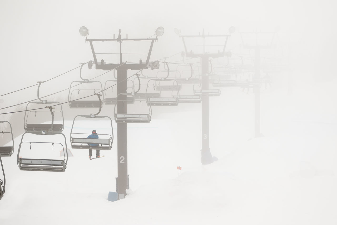 Cold Temperature Day Fog Outdoors Person Ski Lift Snow Sports Winter