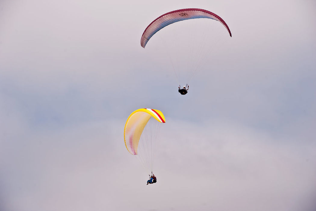 Adventure Danger Day Exhilaration Extreme Sports Flying Gliding Jumping Leisure Activity Lifestyles Low Angle View Mid-air Multi Colored Nature One Person Outdoors Parachute Paragliding Real People RISK Sky Skydiving Sport Stunt Person Unrecognizable Person