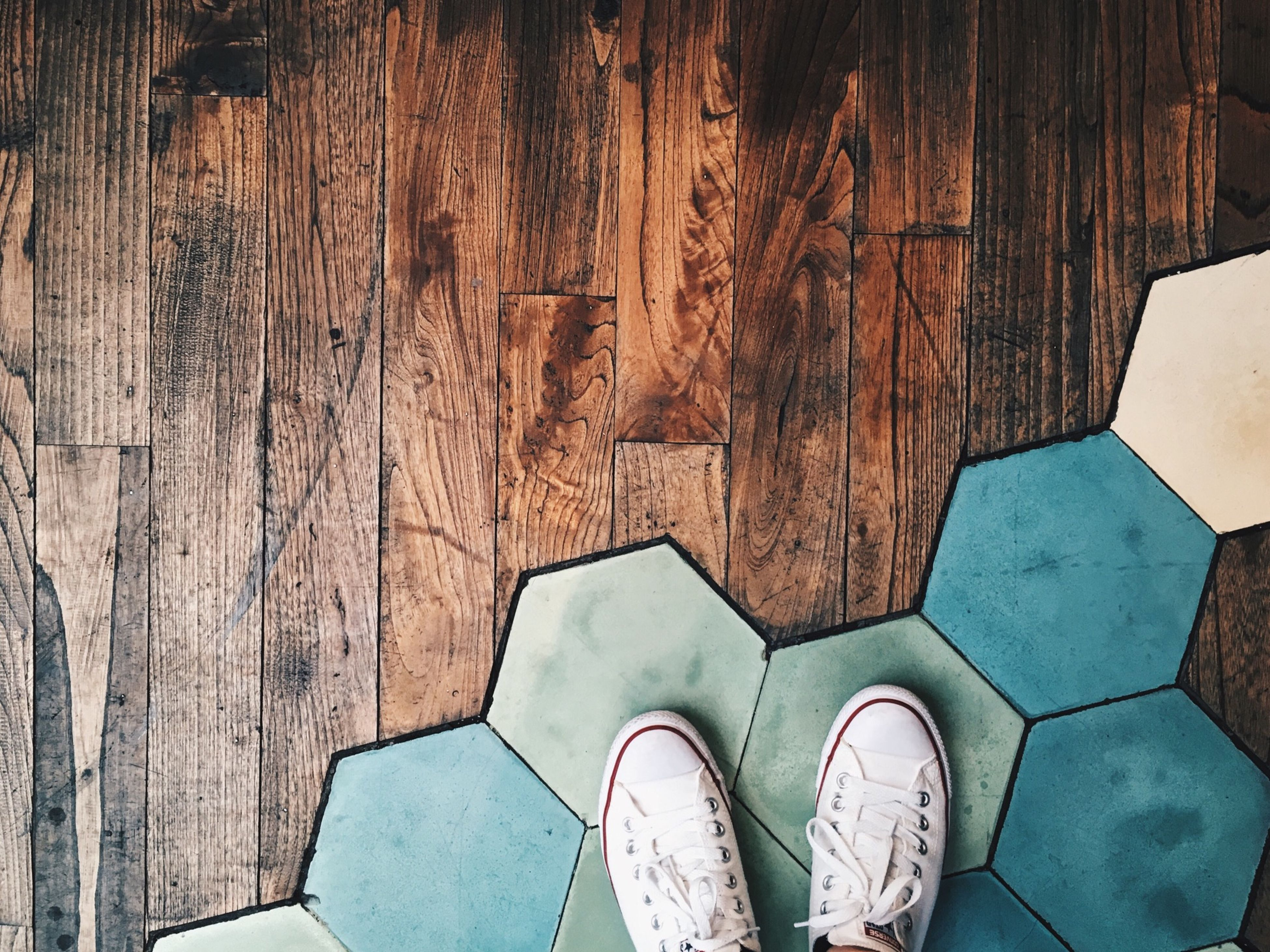 indoors, wood - material, shoe, low section, directly above, high angle view, pattern, built structure, wooden, part of, personal perspective, architecture, design, wood, person, old, arch, footwear, day, wall - building feature