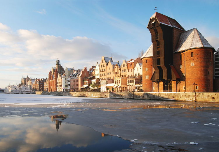 Gdansk old town and famous crane, Polish Zuraw, view from Motlawa river. Architecture Bridge - Man Made Structure Building Exterior Built Structure City Cityscape Crane Day Gdansk Motława No People Old Town Outdoors Sky Travel Travel Destinations Urban Skyline Water Winter Żuraw