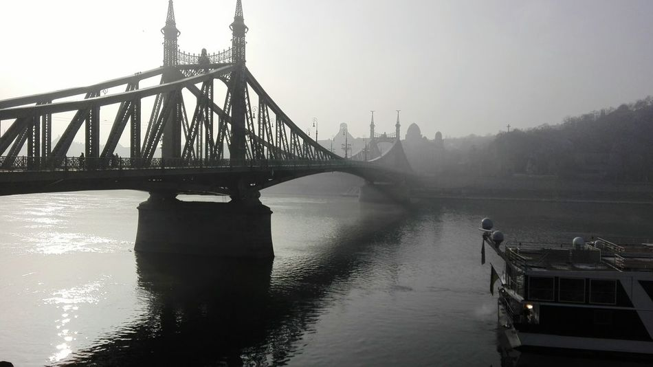 Bridge - Man Made Structure Travel Destinations River Travel City Water Connection Architecture Tourism Outdoors Sky Built Structure Engineering Transportation Business Finance And Industry Suspension Bridge Harbor Cityscape No People Day Budapest Chrixxo Frozen Winter Snow