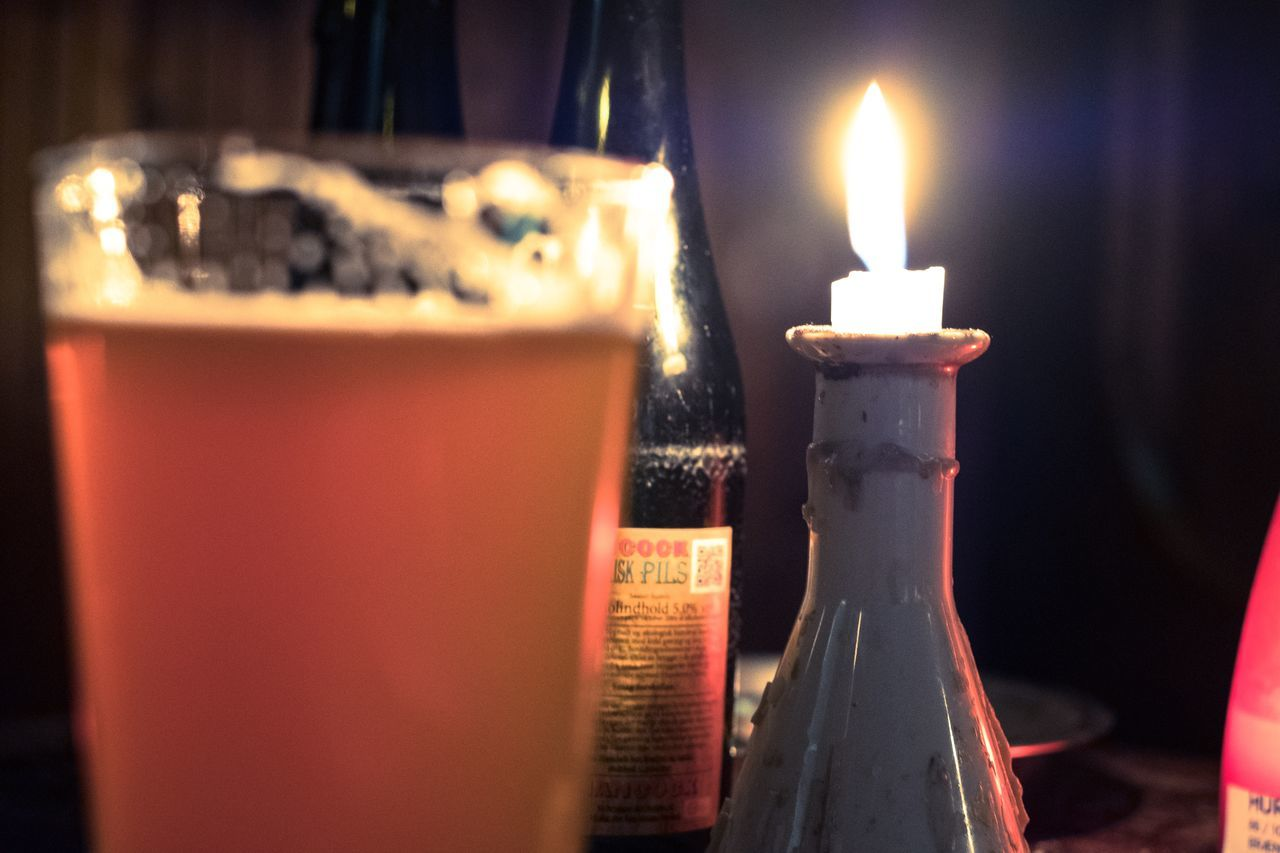 Bar - Drink Establishment Beer Beer Time Burning Candle Candle Candlelight Close-up Copy Space Cozy Draft Beer Drunk Flame Heat - Temperature Illuminated Indoors  Night Nightlife No People Table Tea Light Urban Lifestyle Wax
