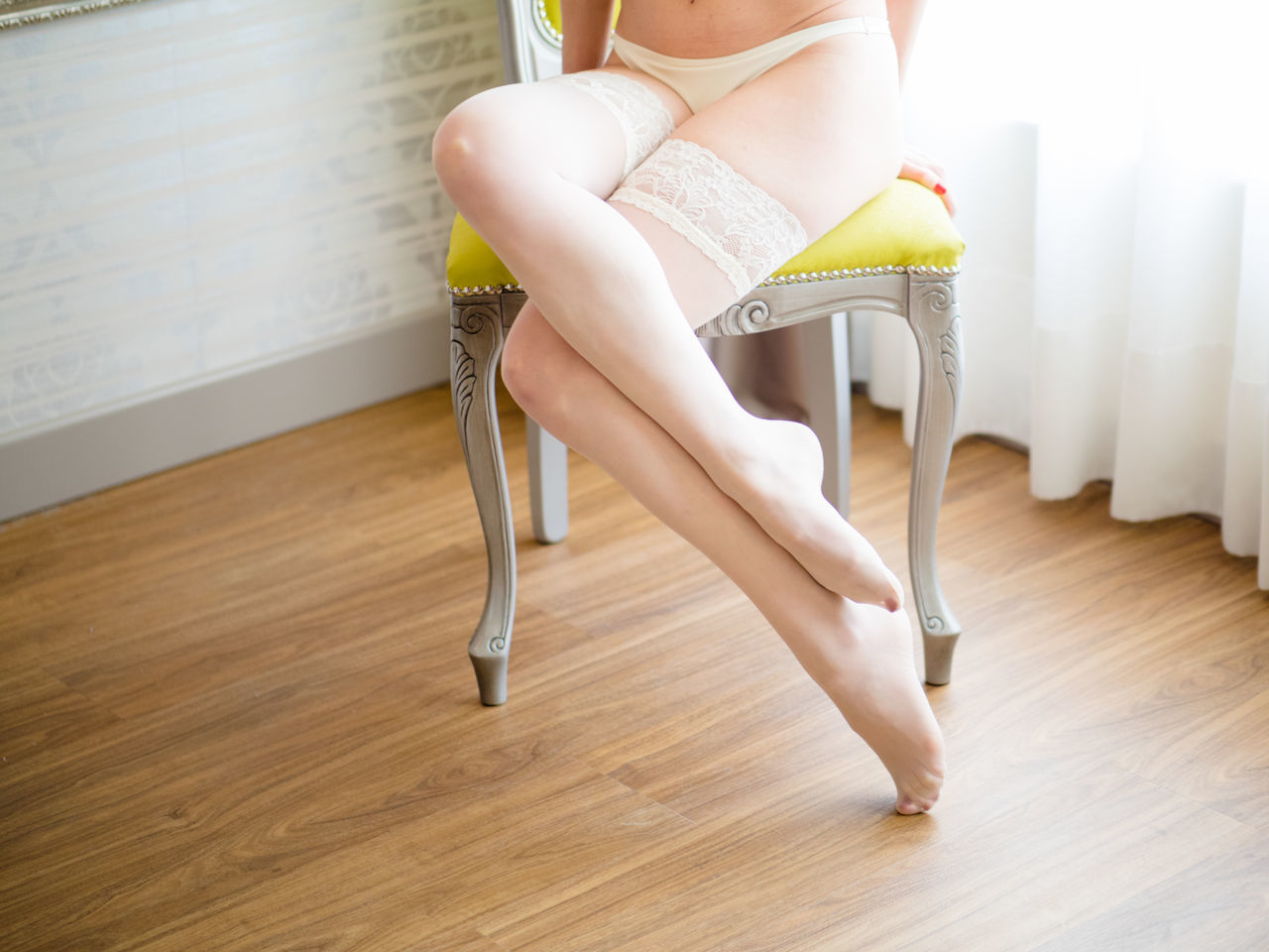 Woman wearing stockings in her bedroom Beauty Close-up Day Domestic Life Domestic Room Females Gold Colored Hardwood Floor Home Interior Human Body Part Human Leg Indoors  Lifestyles Lingerie Low Section One Person One Woman Only Only Women People