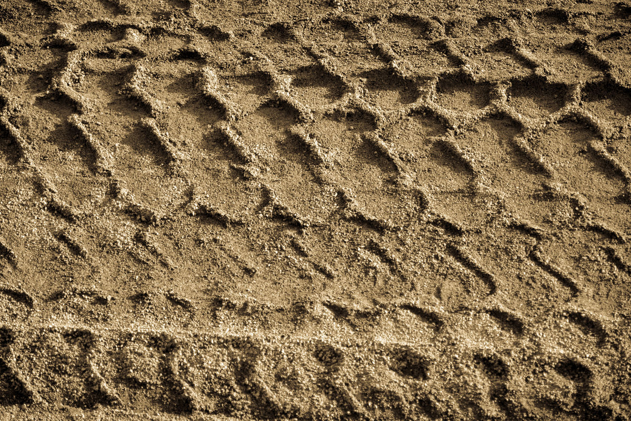 Backgrounds Beach Brown Close-up Day FootPrint Full Frame High Angle View Impronte Nature No People Outdoors Pattern Pneumatic Preumatik Print Sand Sand Print Textured  Tire Print Tire Track