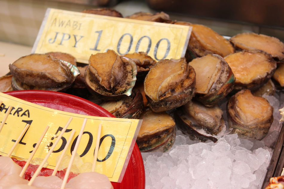 Raw abalone on sale in the Kuromon Ichiba Market, Osaka, Japan Abalone Close-up Communication Day Food Food And Drink Gourmet Kuromon Ichiba Market Market No People Outdoors Price Tag Raw Food Text Winter