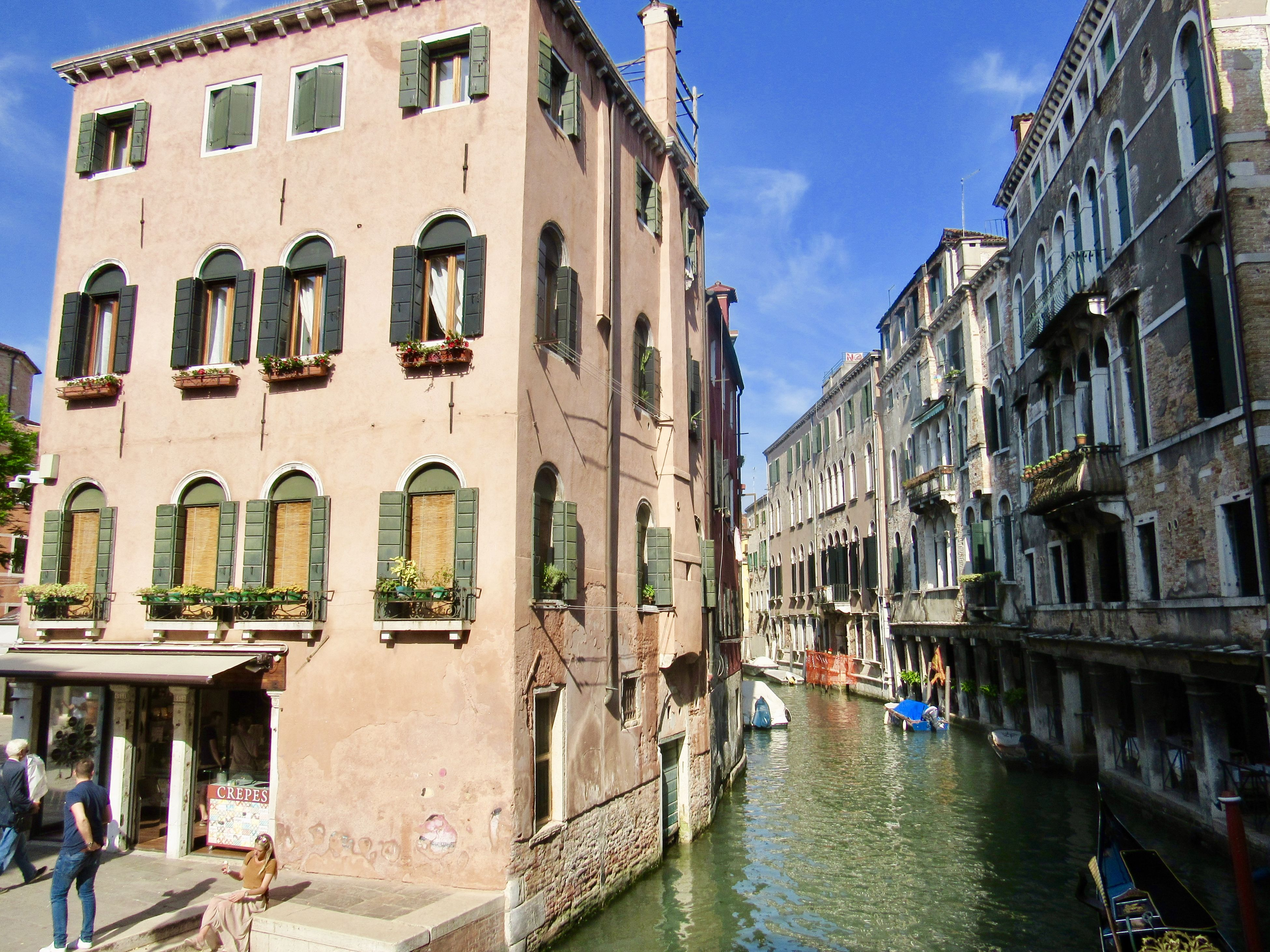 architecture, building exterior, built structure, canal, day, water, arch, outdoors, nautical vessel, waterfront, window, sky, travel destinations, real people, nature, gondola - traditional boat