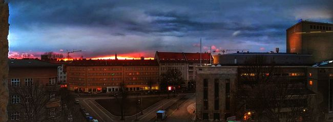 Architecture Building Exterior Built Structure City Sky Illuminated Cityscape Tall - High Cloud Travel Destinations Cloud - Sky City Life Tower Storm Cloud Outdoors Cloudy Moody Sky Residential District Development Office Building The Magic Mission No People Tranquility Rosa-Luxemburg-Platz Battle Of The Cities