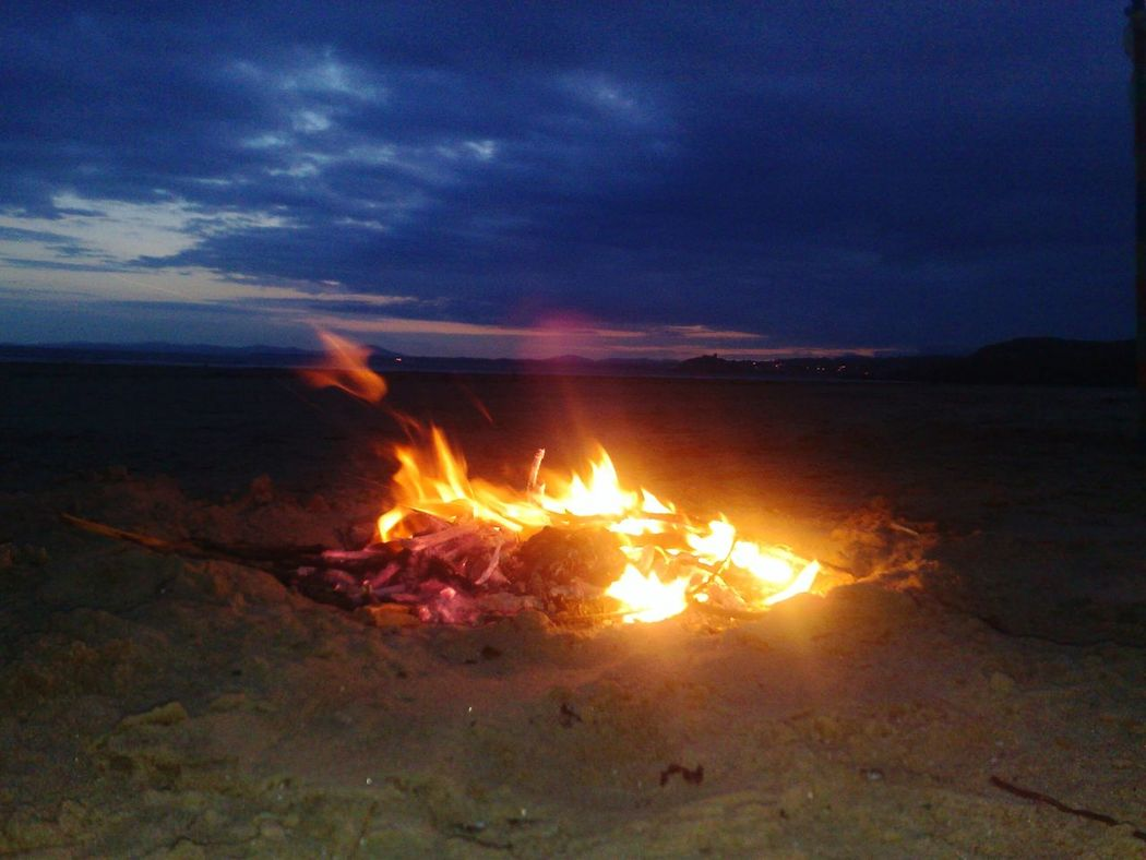 Wales Beach Beach Fire Sunset Clouds And Sky Sand Flickering Flame