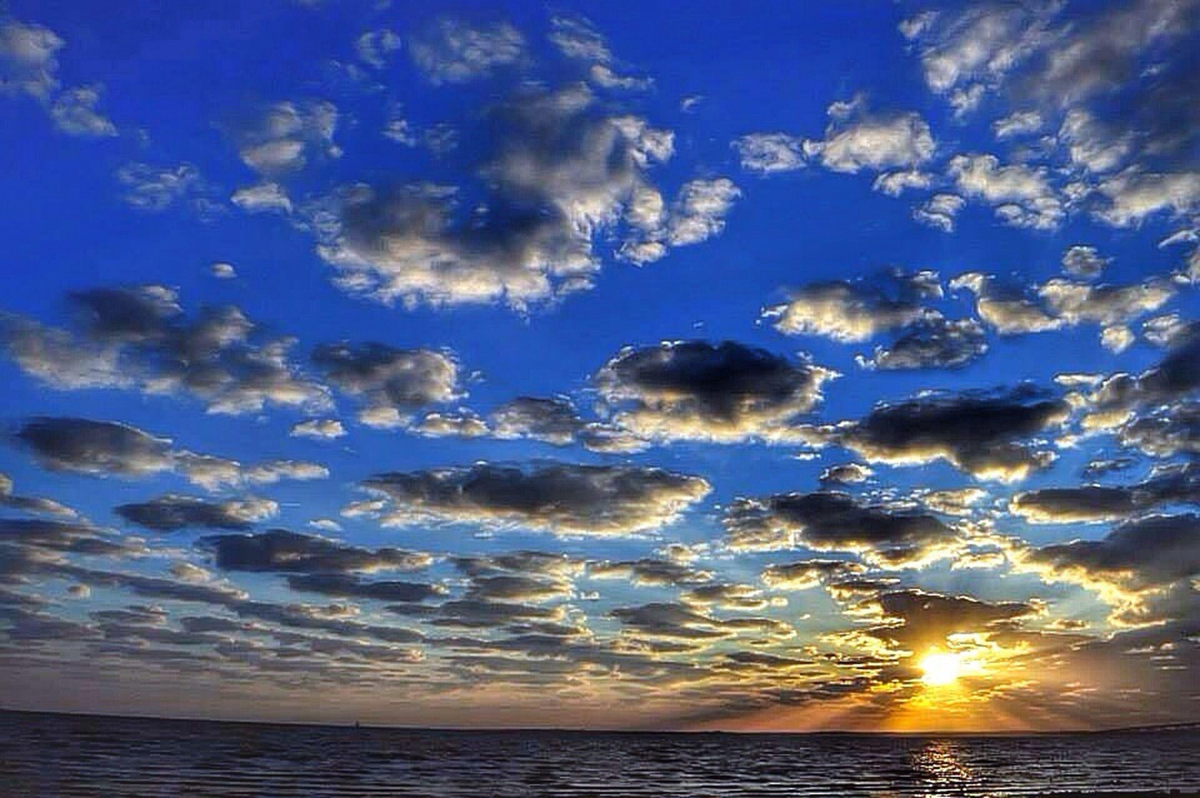 water, sky, sea, scenics, tranquil scene, sun, sunset, beauty in nature, horizon over water, tranquility, cloud - sky, nature, idyllic, reflection, cloud, sunlight, waterfront, sunbeam, beach, blue