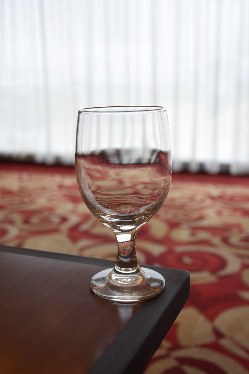 table, food and drink, drinking glass, refreshment, wineglass, red, no people, drink, indoors, wine, close-up, focus on foreground, alcohol, freshness, day
