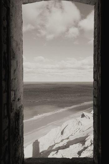 Lighthouse Sea Water Sky Window Shore Beach No People Blackandwhite