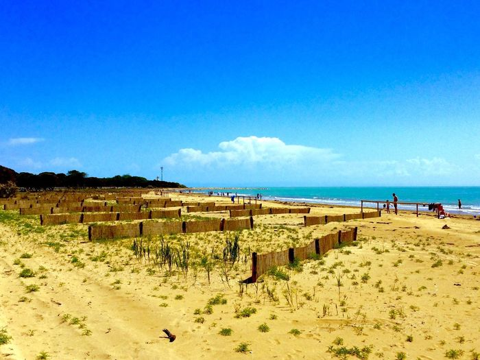 Sand Nature Day Blue Sky Outdoors Sunlight Tranquil Scene Landscape Scenics Beach Tranquility Bibione Bibione Beach  Arid Climate Built Structure Architecture Beauty In Nature No People