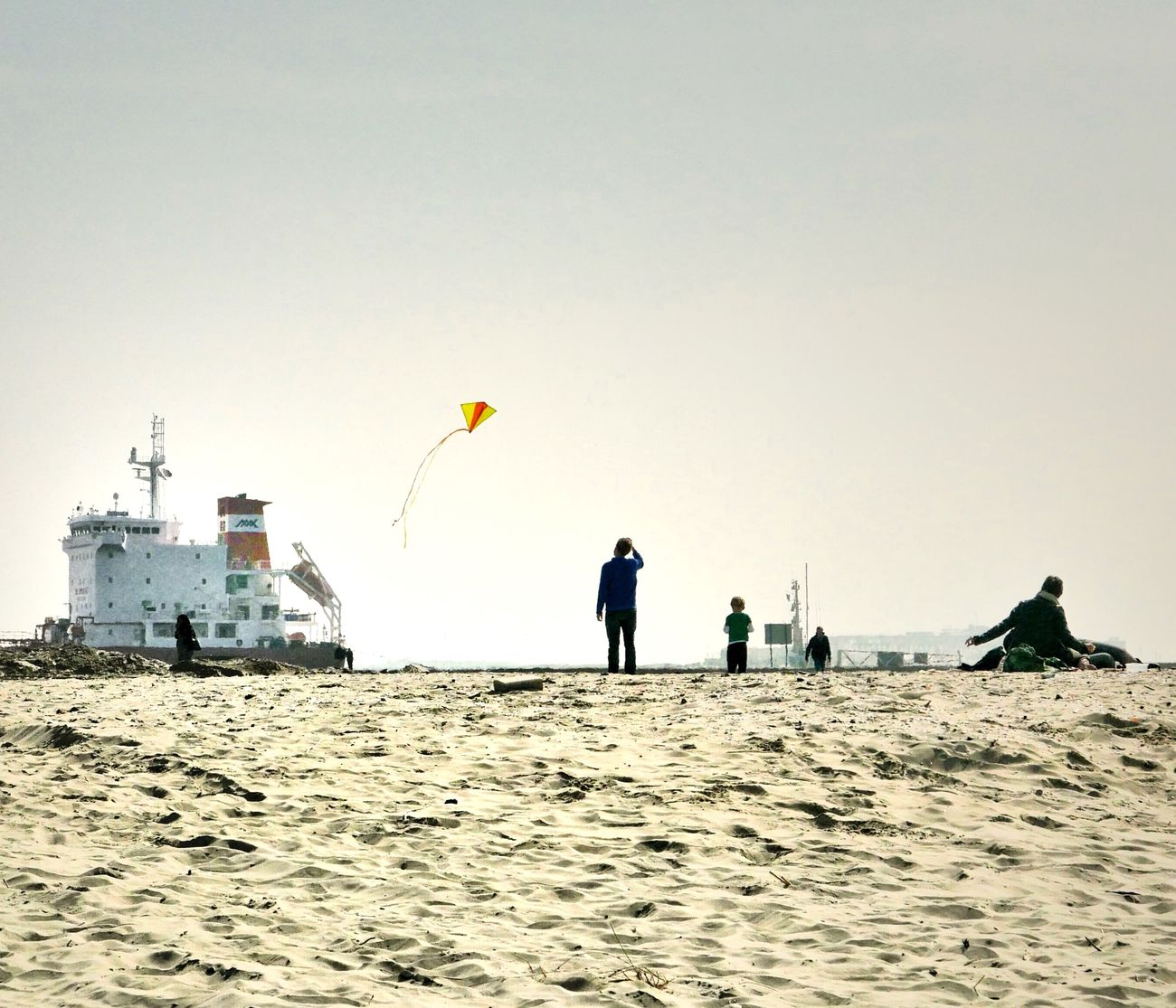 I truly love this shot. Contrast Beachphotography Flying A Kite Kites Relaxing At The Beach Ship Playing In The Sand Learning To Fly OpenEdit