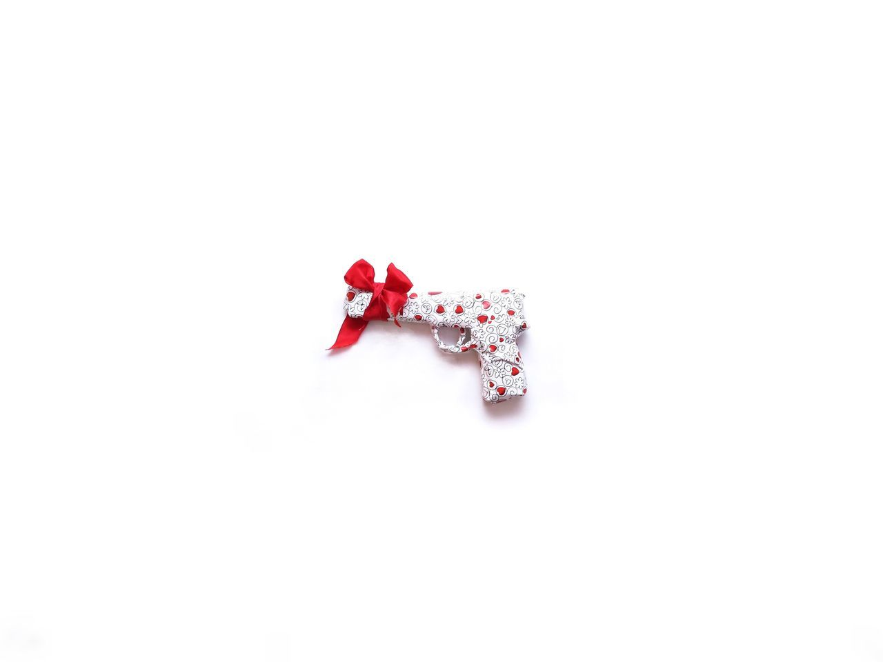 Studio Shot White Background Red Single Object Heart Heart Shape Pistol Gift Present Still Life Creativity Loop No People Red Loop Packed Up Wrapping Paper Paper With Love Give Birthday Christmas Form Shape Secret
