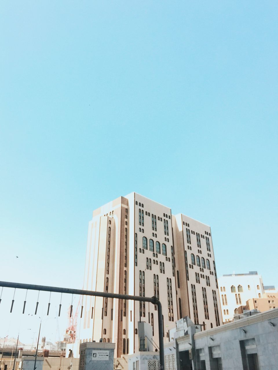copy space, clear sky, architecture, low angle view, building exterior, built structure, day, outdoors, blue, no people, city, sky