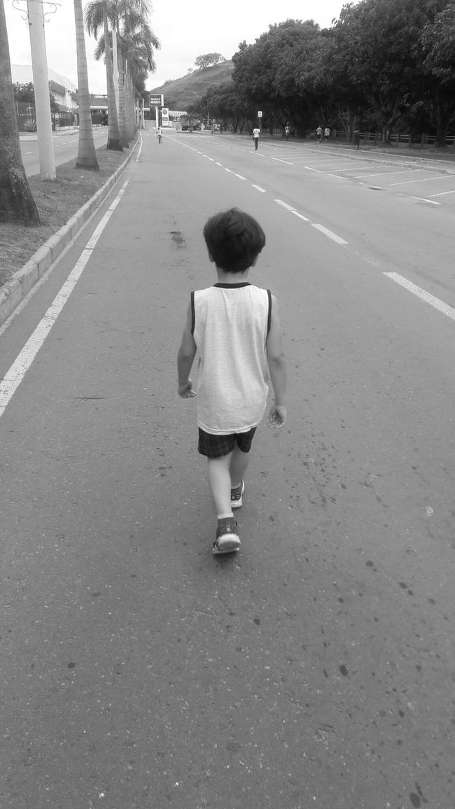 Small walker Child Walking Vertical Outdoors Childhood Rear View Avenue One Boy Black And White