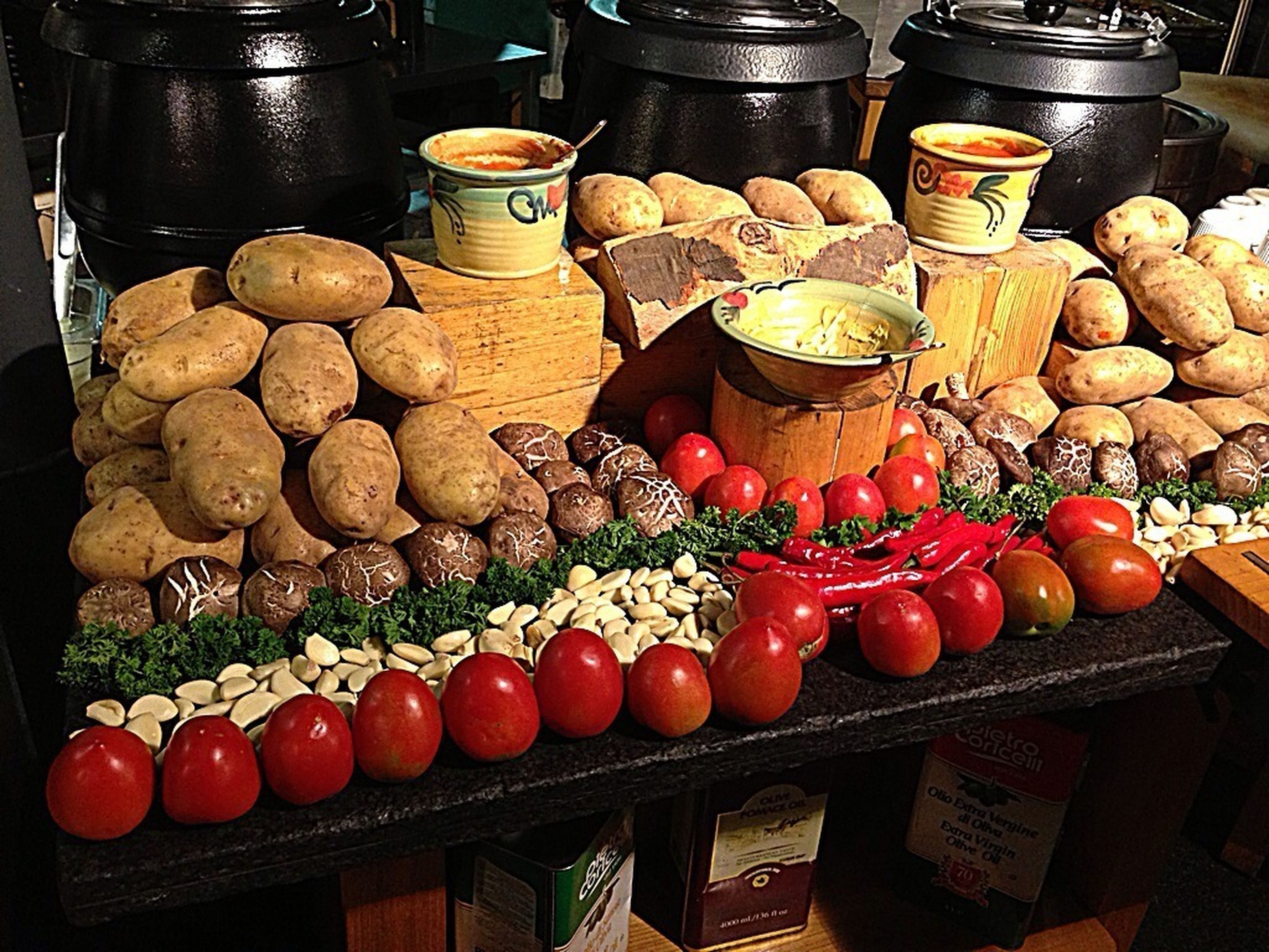 food and drink, food, freshness, healthy eating, still life, large group of objects, abundance, indoors, variation, fruit, for sale, choice, retail, high angle view, container, red, market, table, market stall, vegetable