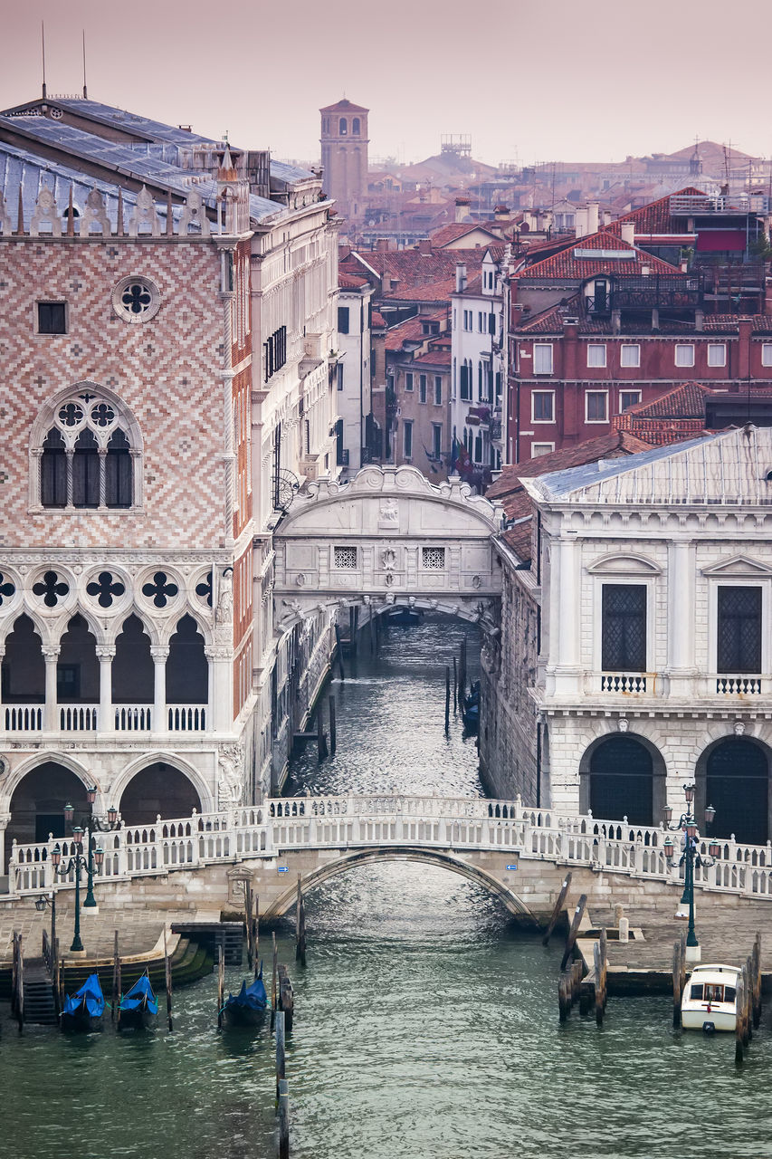 architecture, water, canal, gondola - traditional boat, transportation, arch, bridge - man made structure, built structure, connection, tourism, travel destinations, nautical vessel, building exterior, day, outdoors, no people